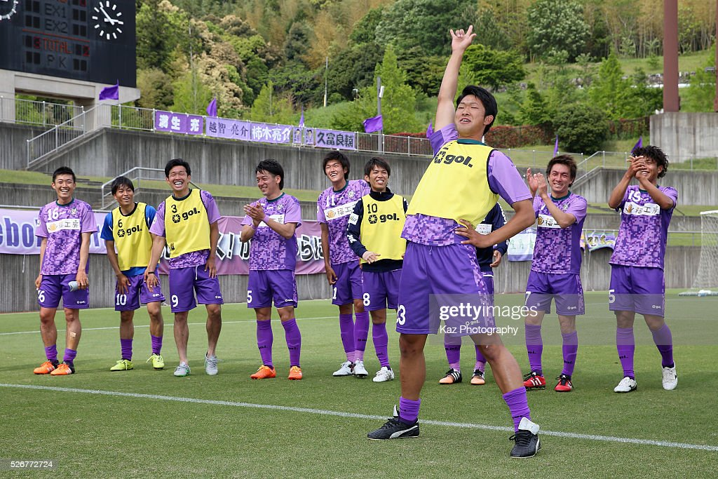 Shota Fujisaki and Fujieda MYFC players celebrate their 3-2 win in the J.League third division match between Fujieda MYFC and Grulla Morioka at the Fujieda Stadium on May 1, 2016 in Fujieda, Shizuoka, Japan.