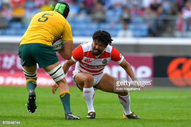 Shota Horie of Japan makes the tackle on Adam Coleman of Australia during the international match between Japan and Australia at Nissan Stadium on...
