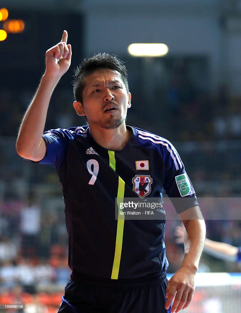 Shota Hoshi of Japan celebrates scoring a goal during the FIFA Futsal World Cup Group C match between Japan and Libya at Indoor Stadium Huamark on November 7, 2012 in Bangkok, Thailand.