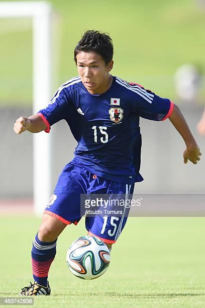 Shota Kaneko of Japan runs with the ball in the U19 match between South Korea and Japan during SBS Cup International Youth Soccer at Kusanagi Stadium...