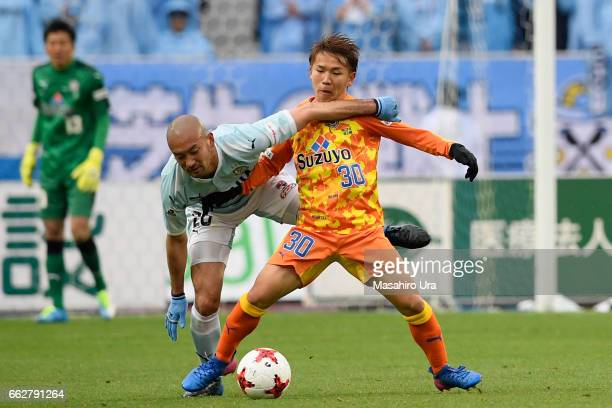 Shota Kaneko of Shimizu SPulse and Kengo Kawamata of Jubilo Iwata compete for the ball during the JLeague J1 match between Jubilo Iwata and Shimizu...