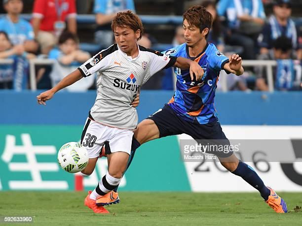 Shota Kaneko of Shimizu SPulse and Kensuke Sato of Yokohama FC compete for the ball during the JLeague second division match between Yokohama FC and...