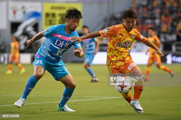 Shota Kaneko of Shimizu SPulse and Takeshi Aoki of Sagan Tosu compete for the ball during the JLeague J1 match between Sagan Tosu and Shimizu SPulse...