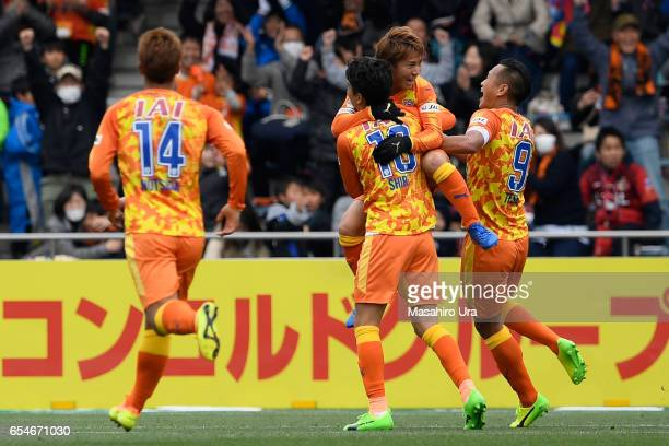 Shota Kaneko of Shimizu SPulse celebrates scoring the opening goal with his team mates during the JLeague J1 match between Shimizu SPulse and Kashima...