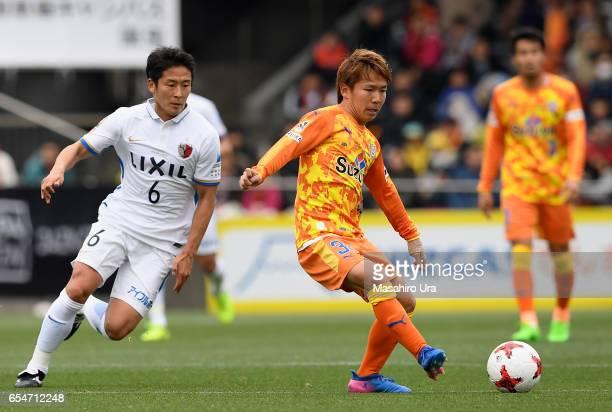 Shota Kaneko of Shimizu SPulse controls the ball under pressure of Ryota Nagaki of Kashima Antlers during the JLeague J1 match between Shimizu SPulse...