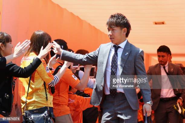 Shota Kaneko of Shimizu SPulse high five with supporters prior to the JLeague J1 match between Shimizu SPulse and Vegalta Sendai at IAI Stadium...