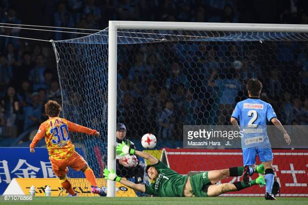 Shota Kaneko of Shimizu SPulse scores the opening goal past Jung Sung Ryong of Kawasaki Frontale during the JLeague J1 match between Kawasaki...