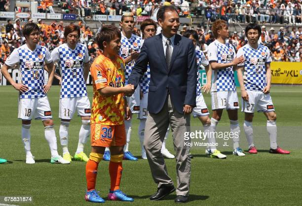 Shota Kaneko of Shimizu SPulse shakes hands with JLeague vice chairman Hiromi Hara druing the ceremony of the JLeague J1's 20000th goal prior to the...