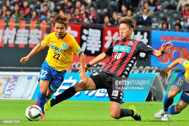 Shota Kaneko of Tochigi SC and Hiroki Miyazawa of Consadole Sapporo compete for the ball during the JLeague second division match between Consadole...