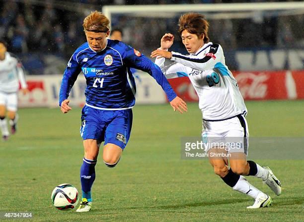 Shota Kawanishi of Montedio Yamagata and Shintaro Kurumaya of Kawasaki Frontale compete for the ball during the JLeague match between Montedio...