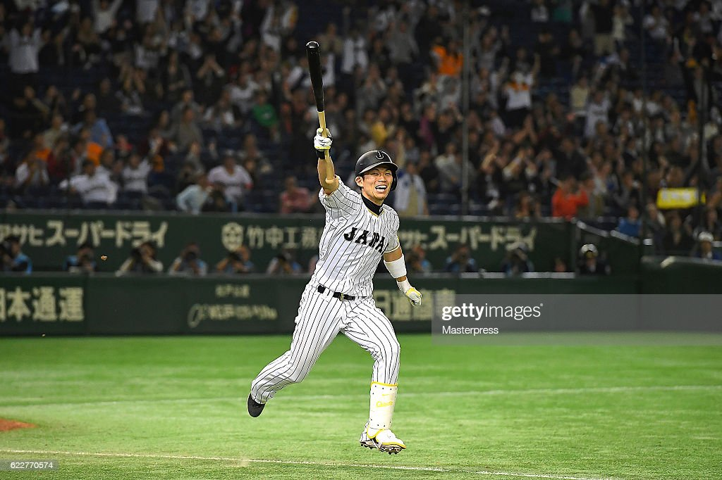Shota Ohno #27 of Japan celebrates after hitting a RBI in the tenth inning to win during the international friendly match between Japan and Netherlands at the Tokyo Dome on November 12, 2016 in Tokyo, Japan.