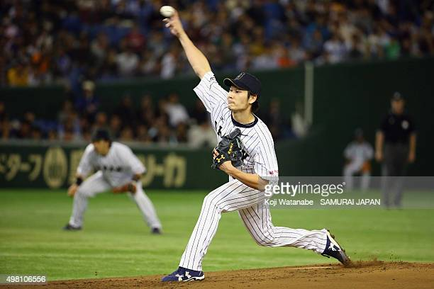 Shota Takeda of Japan pitches during the WBSC Premier 12 third place play off match between Japan and Mexico at the Tokyo Dome on November 21 2015 in...