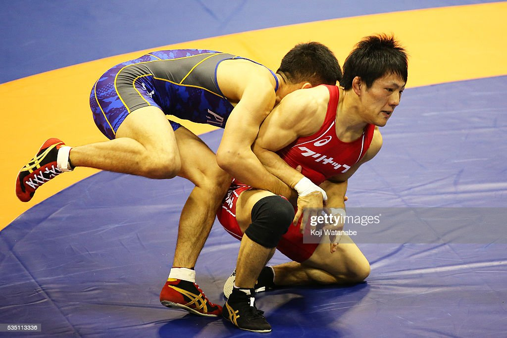Shota Tanokura (red) competes in the Men's 59kg greco-roman style second rounds match against Hayanobu Shimizu (blue) during All Japan Wrestling Championships at Yoyogi National Gymnasium on May 29, 2016 in Tokyo, Japan.