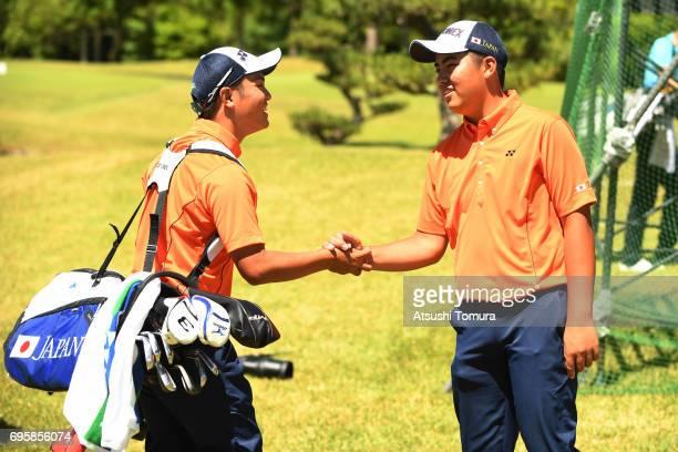 Shota Ueki of Japan and Mahiro Sanda of Japan smile during the second round of the 2017 TOYOTA Junior Golf World Cup at the Chukyo Golf Club Ishino...