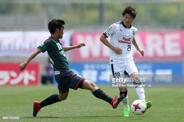 Shota Yomesaka of Gamba Osaka and Daiki Numa of Gainare Tottori compete for the ball during the JLeague J3 match between Gainare Tottori and Cerezo...