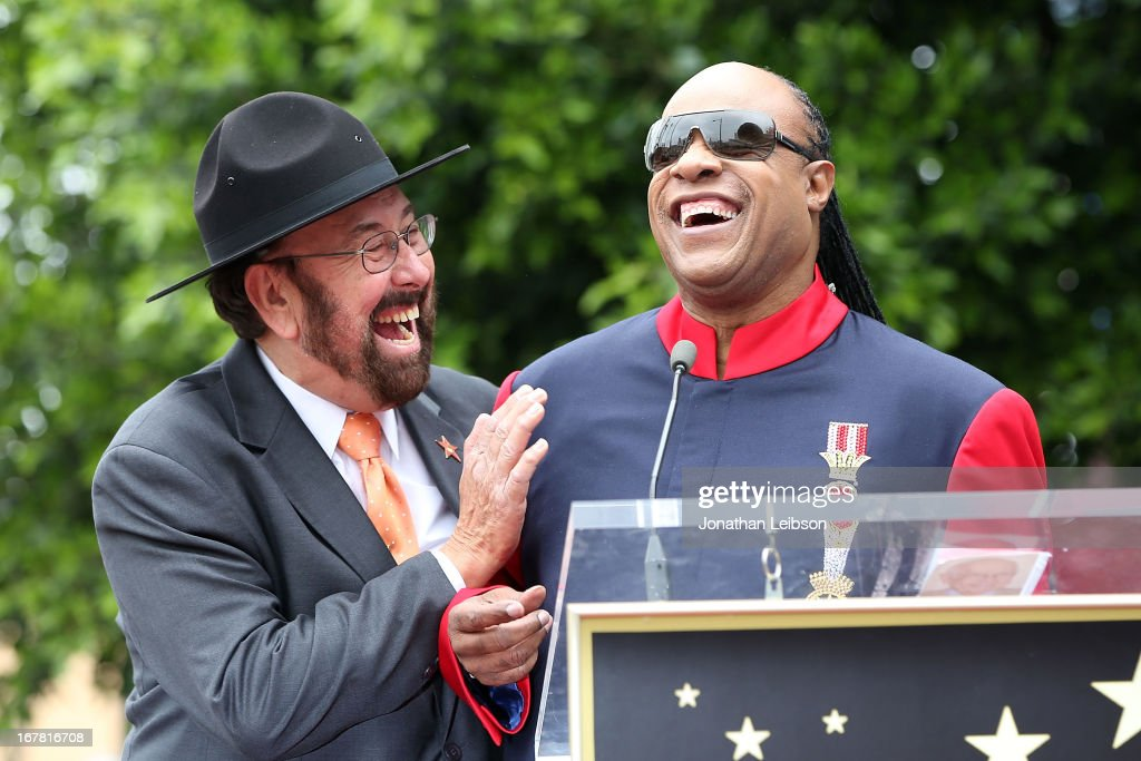 'Shotgun Tom' Kelly and <a gi-track='captionPersonalityLinkClicked' href=/galleries/search?phrase=Stevie+Wonder&family=editorial&specificpeople=171911 ng-click='$event.stopPropagation()'>Stevie Wonder</a> attend the ceremony honoring 'Shotgun Tom' Kelly with a star on The Hollywood Walk of Fame held on April 30, 2013 in Hollywood, California.
