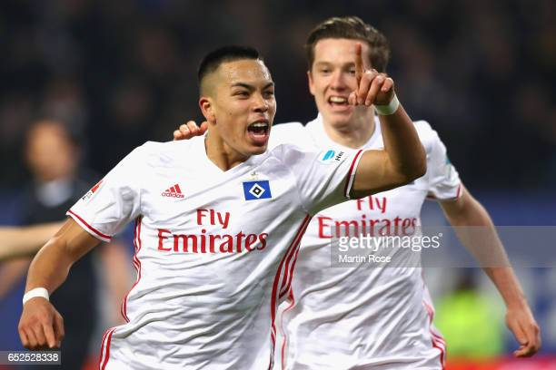 Shou Bobby Wood of Hamburg celebrates scoring the 2ndt team goal with his team mate Michael Gregoritsch during the Bundesliga match between Hamburger...