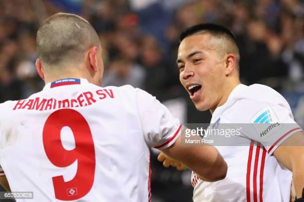 Shou Bobby Wood of Hamburg celebrates scoring the 2ndt team goal with his team mate Kyriakos Papadopoulos during the Bundesliga match between...