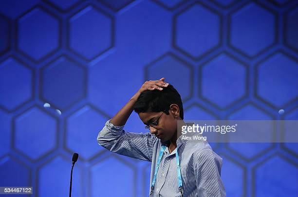 Shourav Dasari of Spring Texas reacts after he misspelled his word in the finals of the 2016 Scripps National Spelling Bee May 26 2016 in National...