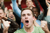 Shouting man at football match