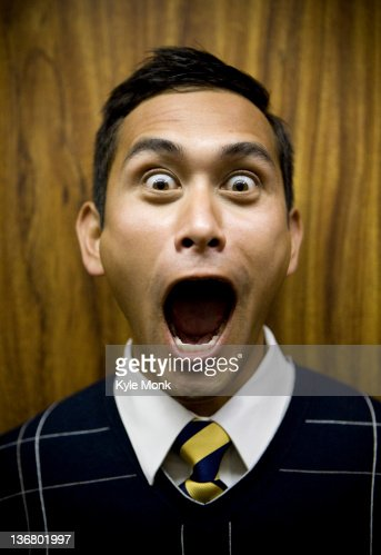 Shouting mixed race businessman