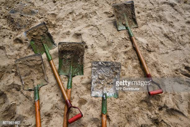 A shovel covered in palm oil is seen on a beach as volunteers try to clear washed up oil on Hong Kong's outlying Lamma Island on August 8 2017...