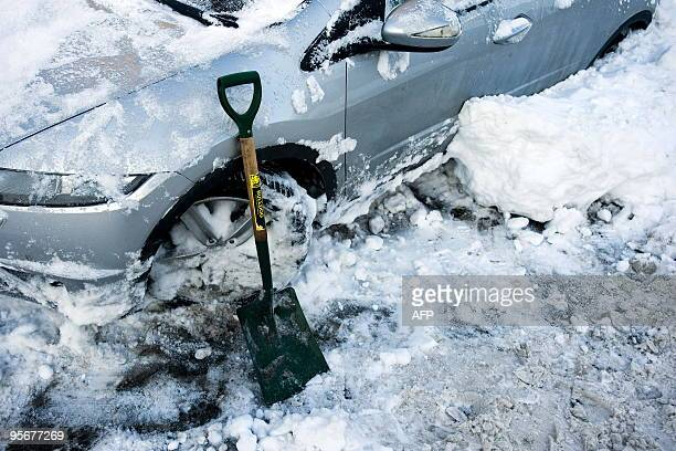 A shovel is pictured beside a car in Denholm in Scotland on January 7 2010 Eurostar passengers faced new winter misery when another highspeed train...