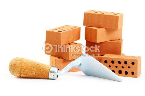 A shovel tool and several stacked bricks : Stock Photo