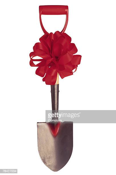 Shovel with red bow