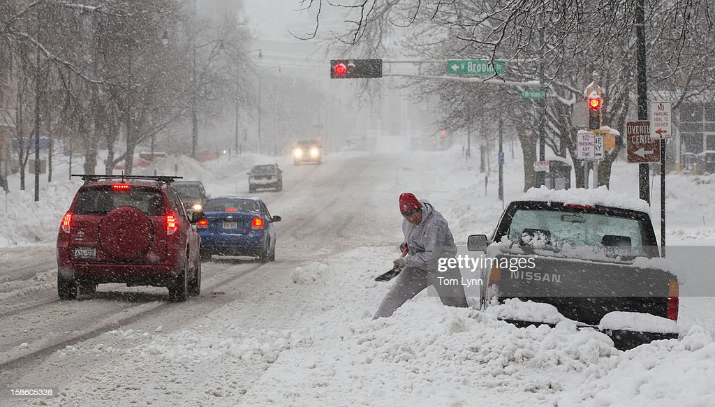Shoveling out cars was just one of the battles of the storm on December 20, 2012 in in Madison, Wisconsin. The State Patrol was warning motorists to stay home as a paralyzing winter storm bore down on Wisconsin In the first significant snowstorm to hit southern Wisconsin in two winters.