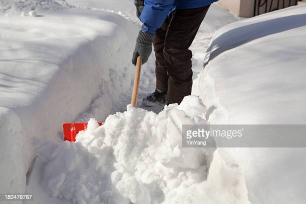 Shoveling Removing Snow at Residential Home After Winter Blizzard Storm