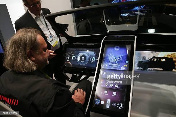 Show attendees check out a prototype of a connected car console built with Gorilla Glass at CES 2016 at the Las Vegas Convention Center on January 7...