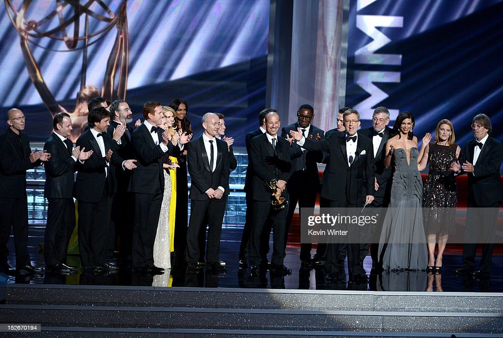 Show creator Gideon Raff, writers Howard Gordon and Alex Gansa with cast and crew members accept the Outstanding Drama Series Award for 'Homeland' onstage during the 64th Annual Primetime Emmy Awards at Nokia Theatre L.A. Live on September 23, 2012 in Los Angeles, California.