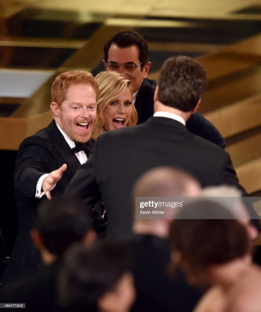 Show creator Steven Levitan (R) with actors Jesse Tyler Ferguson, Julie Bowen and Ty Burrell accept Outstanding Comedy Series for 'Modern Family' onstage at the 66th Annual Primetime Emmy Awards held at Nokia Theatre L.A. Live on August 25, 2014 in Los Angeles, California.