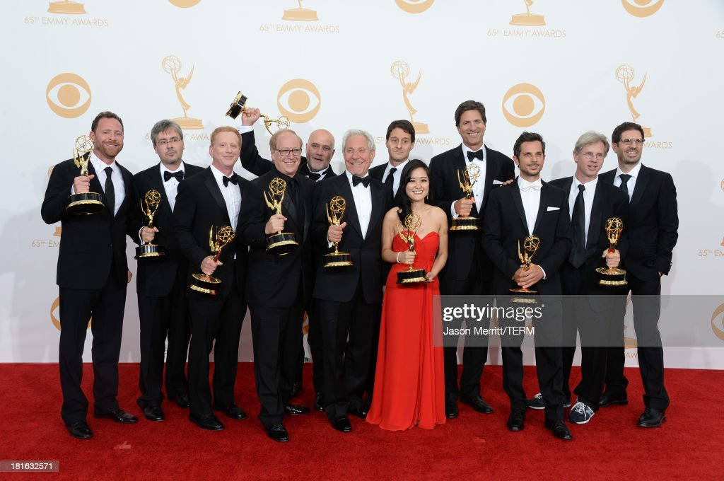 Show Creator <a gi-track='captionPersonalityLinkClicked' href=/galleries/search?phrase=Steven+Levitan&family=editorial&specificpeople=3219544 ng-click='$event.stopPropagation()'>Steven Levitan</a> (4th from R) with producers, winners of Outstanding Comedy Series for 'Modern Family,' pose in the press room during the 65th Annual Primetime Emmy Awards held at Nokia Theatre L.A. Live on September 22, 2013 in Los Angeles, California.