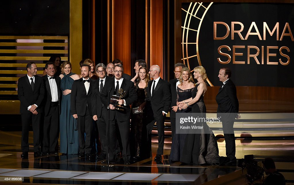 Show creator Vince Gilligan (C) with cast and crew accept Outstanding Drama Series for 'Breaking Bad' onstage at the 66th Annual Primetime Emmy Awards held at Nokia Theatre L.A. Live on August 25, 2014 in Los Angeles, California.