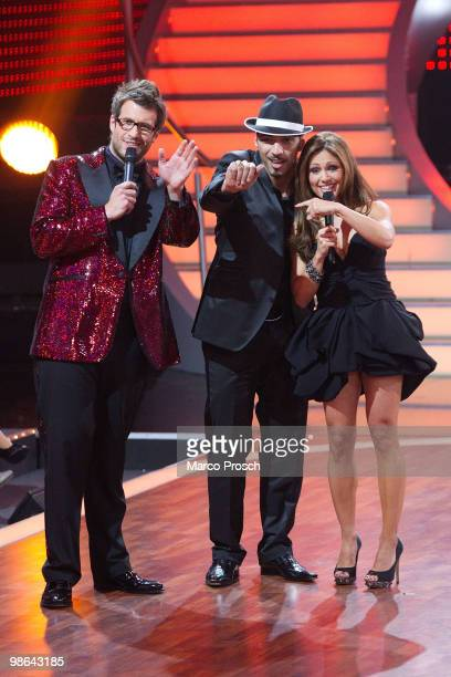 Show host Daniel Hartwich and cohost Nazan Eckes wave to the cameras together with Mehrzad Marashi during the 'Let's Dance' TV show at Studios...