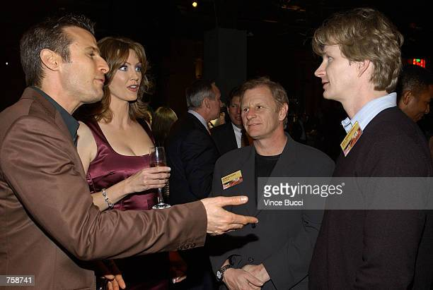 Show host Wendy Walsh and correspondent AJ Hammer talk with NYPD Blue actors Gordon Clapp and Bill Brochtrup at celebration of the oneyear...