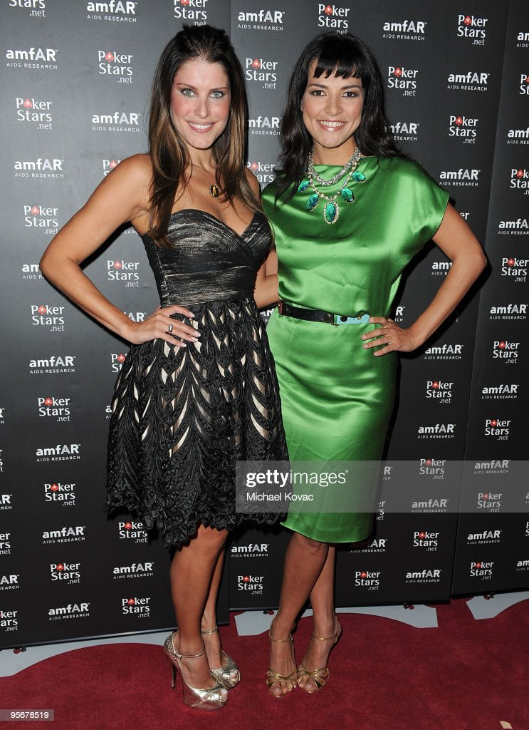 Show Hosts Ana Luiza Castro (L) and Candela Ferro attend the amfAR Cocktail Party & PokerStars Red Carpet And Party at Aura Nightclub on January 9, 2010 in Nassau, Bahamas.