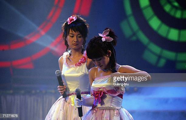 TV show hosts for 'Super Girl Voice' stand on stage at Hunan Satellite TV station on June 21 2006 in Changsha city Hunan province of China 'Super...