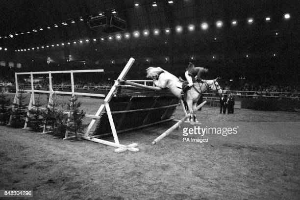 Show jumper Harvey Smith fails in his attempt to break the 40 year old record of jumping a height of 7ft 61/4 inch Harvey Smith retired his attempt...