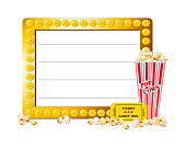 Illuminated show sign with blank copy space, popcorn and a ticket