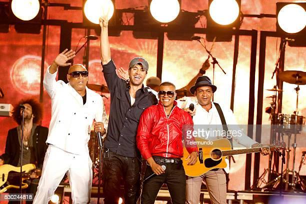 Alexander Delgado Enrique Iglesias Randy Malcom Martinez of Gente De Zona and Descember Bueno on stage during the 2014 Billboard Latin Music Awards...