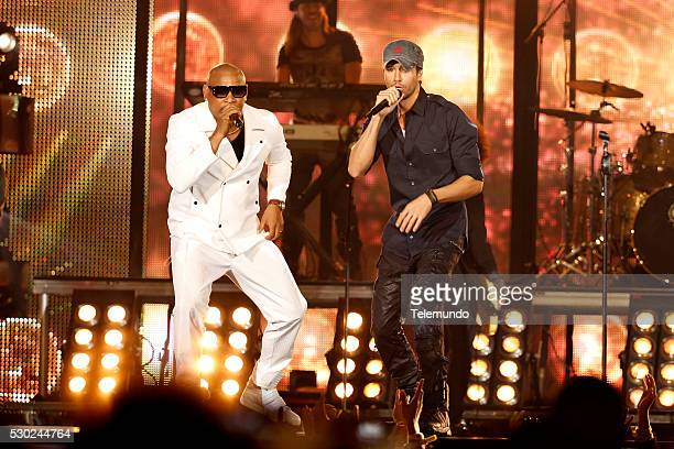 Alexander Delgado of Gente De Zona Enrique Iglesias on stage during the 2014 Billboard Latin Music Awards from Miami Florida at the BankUnited Center...