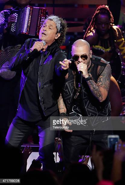 Carlos Vives and Wisin on stage during the 2015 Billboard Latin Music Awards from Miami Florida at the BankUnited Center University of Miami on April...
