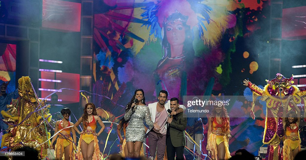 Gaby Espino, Aaron Diaz and Tito El Bambino on stage during the 2013 Premios Tu Mundo from the American Airlines Arena in Miami, Florida, August 15, 2013 -- (Photo by: Gary I Rothstein/Telemundo) ..PREMIOS TU MUNDO 2013 -- Programa -- Imagen: L-R) Gaby Espino, Aaron Diaz and Tito El Bambino en el escenario de los Premios Tu Mundo 2013 desde el American Airlines Arena en Miami, Florida, 15 de Agosto, 2013 --