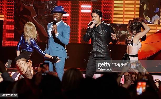 NeYo and Luis Fonsi on stage during the 2015 Billboard Latin Music Awards from Miami Florida at the BankUnited Center University of Miami on April 30...