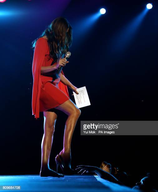 Show presenter Lisa Snowdon removes her shoes on stage during the 2011 Capital FM Jingle Bell Ball at the O2 Arena London