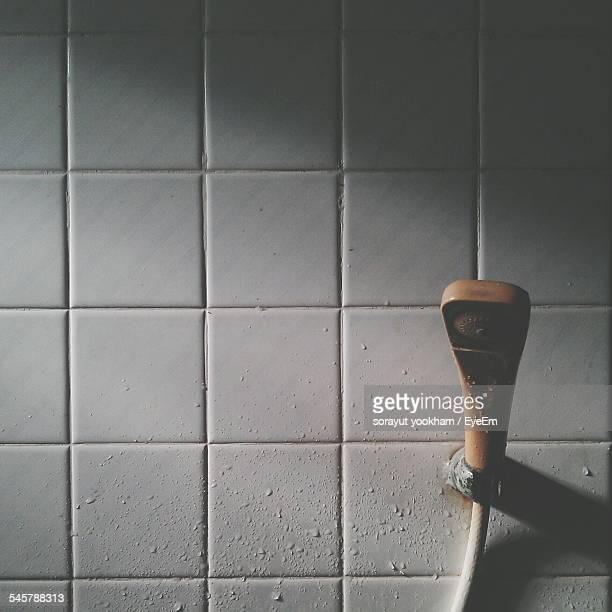 Shower Against Tiled Wall In Bathroom