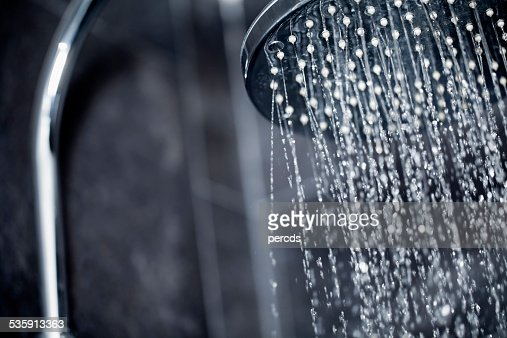 Shower head sprinkling water : Stock Photo
